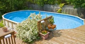 piscine in acciaio fuori terra con solarium in legno